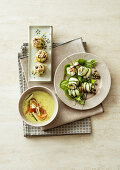 Cold cucumber soup, cucumber filled with tuna and cucumber rolls with sword fish
