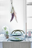 Dried grasses on wall above set Easter table