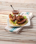 Grilled meat with barbecue sauce on corn tortillas