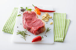 Raw loin steak and ingredients