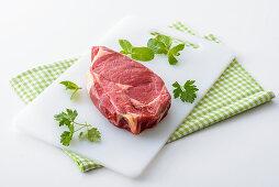 A raw loin steak