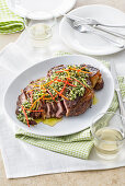 A loin steak with herb and almond pesto