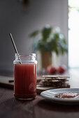 A jar of apple preserve with crisp bread