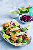 Fried fish tacos with guacamole sauce