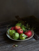 Apples and pears on a rustic wooden table