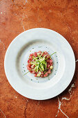 Tuna ceviche with cucumber, apple and chives