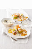 Fish rolls with a mustard Bechamel and fried potatoes