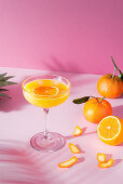 Orange cocktail in a tall stem glass