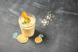 A mango smoothie in a glass