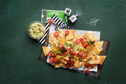 Nachos with guacamole for a Super Bowl party
