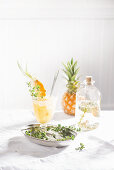 A sparkling summery pineapple drink with thyme syrup