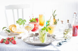 Various sparkling summer cocktails on a tray