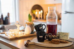 Cheese, biscuits, cups and mulled wine