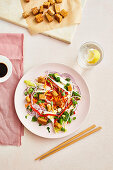 Asian roasted tempeh salad with red onion, coriander, red pepper, spring onion and grated carrot
