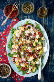 Salad with avocado, dried tomatoes and feta