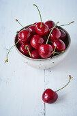 Fresh cherries in dish
