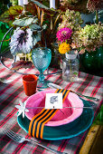 Colourful place setting decorating with ribbon, tag and flower