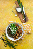 Roast potatoes with lentils, spring onions and chive mayonnaise