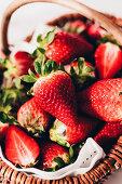 Fresh strawberries in a wicker basket