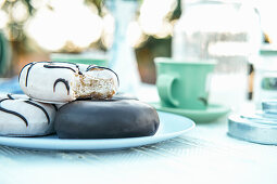 Composition of aromatic hot drink and tasty donuts on table