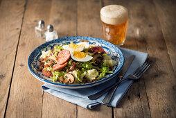 Rheinisches Durcheinander (salad with mashed potatoes, sausage and egg)