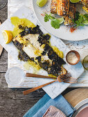 Murray cod with vine leaves and preserved lemon