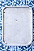 Grey tray on blue background