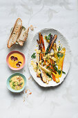 Yellow pepper sauce with chorizo, and almond sauce with oven-roasted vegetables