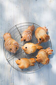Hen-shaped sweet buns for Easter on cooling rack