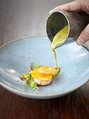 Scallops and marinated veal tongue in a pumpkin, orange and curry broth