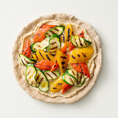 Pan pizza with hummus and grilled vegetables