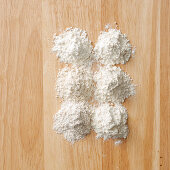 Wheat flour types on a wooden background