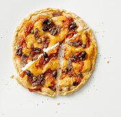Ligurian style pizza with olives, capers and tomato