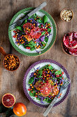 Vegetarian salad with spicy chick peas, blood orange, red cabbage and rocket salad