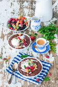 Hot chocolate cakes with berries and ice cream