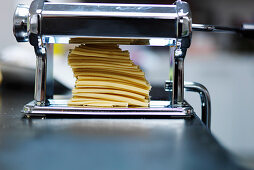 Rolling fresh pasta with a pasta machine