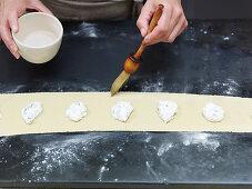 Preparing filled pasta: brush pastry edges