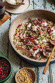 Shredded Lamb with Pomegranate, Tahini Yoghurt, Pine Nuts