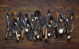 Old cutlery on a wooden background