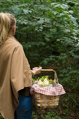 Woman with a full picnic basket