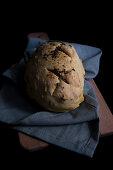Handmade bread on the wuden cutting board