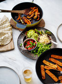 Mexican fajitas meal with dishes to make your own tacos