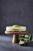 Lime cheesecake on a cake stand