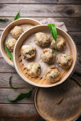 Vegan wild garlic bread dumplings made in a bamboo steamer