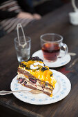 A slice of blackberry cake and a cup of tea