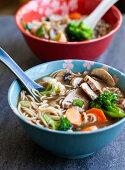 Ramen with pork, mushrooms, broccoli, carrots, cauliflower and green onions (Japan)