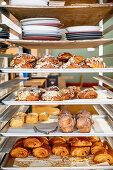 Sweet pastries on a shelf in a bakery