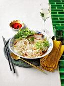 Roasted pork belly and dumpling noodle soup