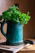 Fresh parsley in a vintage measuring jug