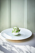 William's pear sorbet in a meringue ball with peach and verbena